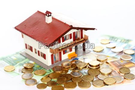 euro dinheiro e casa