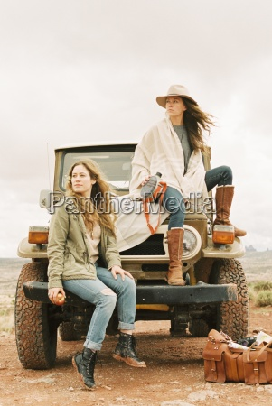 two women sitting on the front