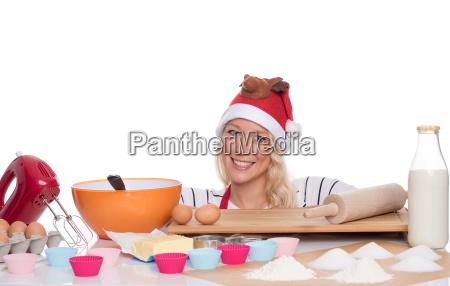 mulher com chapeu do natal coze