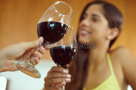 women celebrating at home doing toast