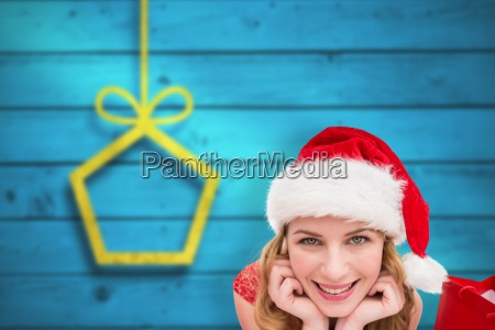 composite image of smiling woman lying