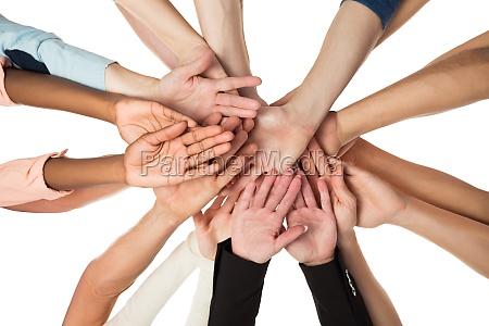creative business team piling hands