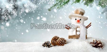 seasonal background with happy snowman