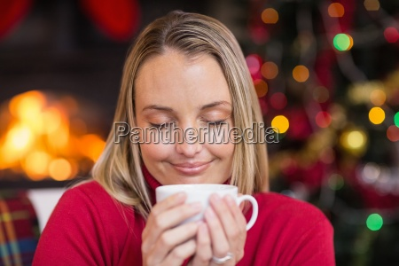 pretty blonde enjoying a hot drink