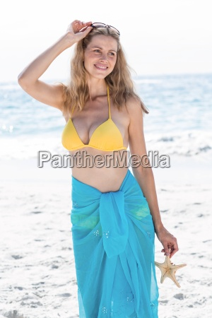 smiling pretty blonde in bikini holding