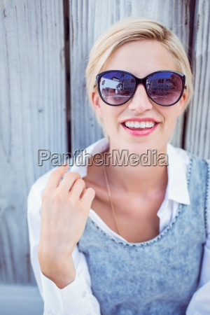 pretty blonde woman wearing sun glasses