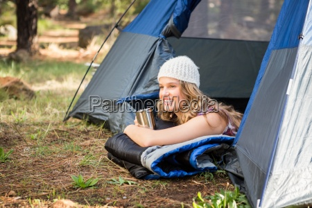 pretty blonde camper smiling and lying