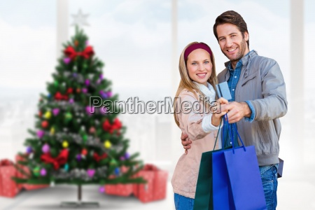 composite image of smiling couple showing