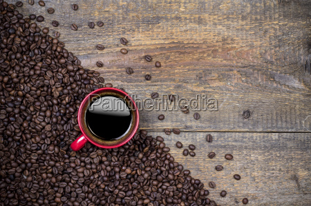 coffee beans and red coffee cup