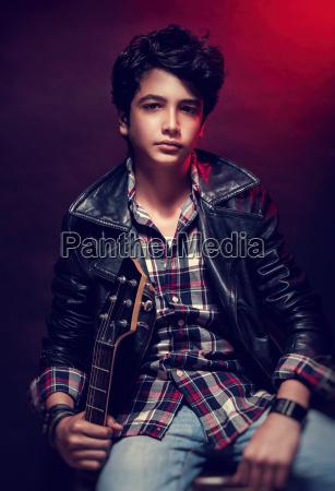 handsome teen guitarist