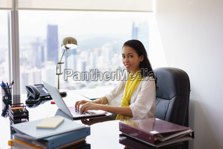 business woman assistant typing on pc