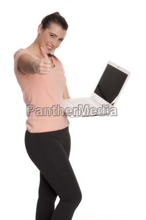 young woman on laptop showing thumbs