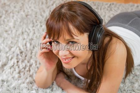 young woman enjoying music in