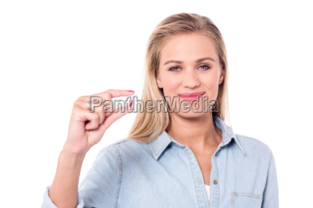 smiling woman with a pill in