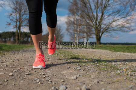 jogger running on a dirt road