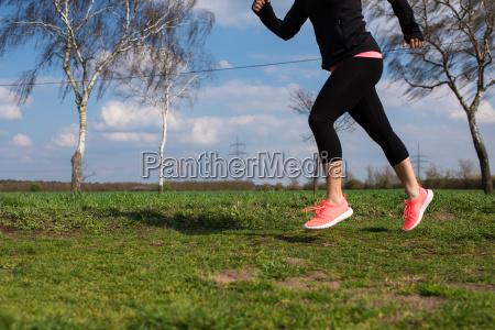 jogger running on a meadow in