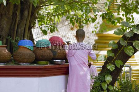 burmese girl monk getting fresh water