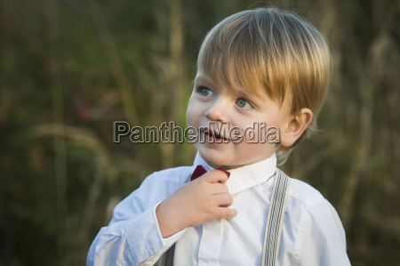 blond boy wearing tie and shirt