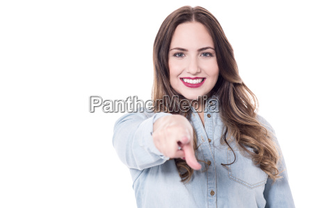 happy young lady pointing at you