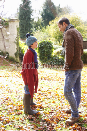 father and son walking in autumn