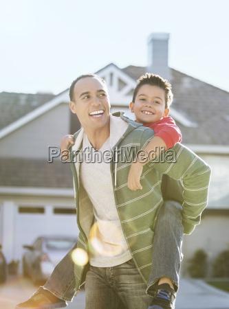 father piggybacking son