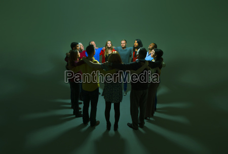 business people in circle around bright