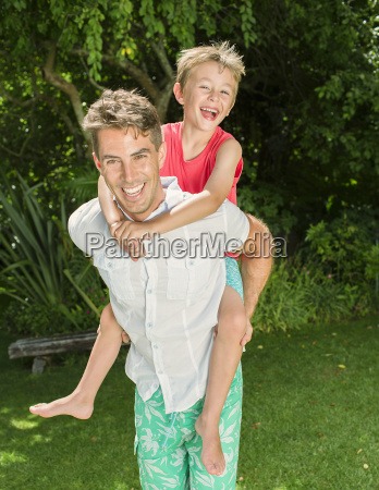 father and son playing in backyard
