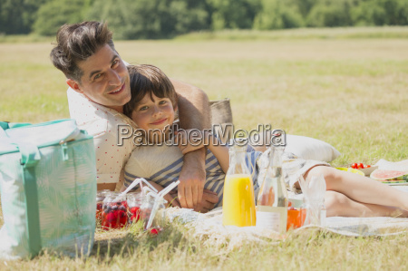 portrait affectionate father and son relaxing