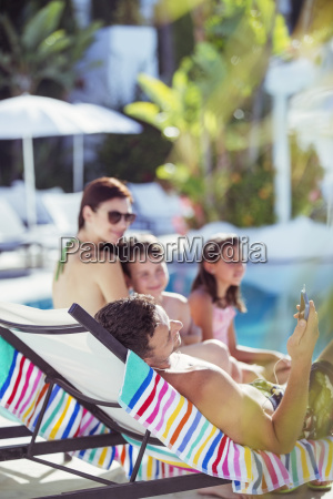 family with two children relaxing by