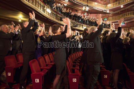audience applauding in theater
