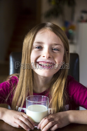 portrait of happy girl with glass