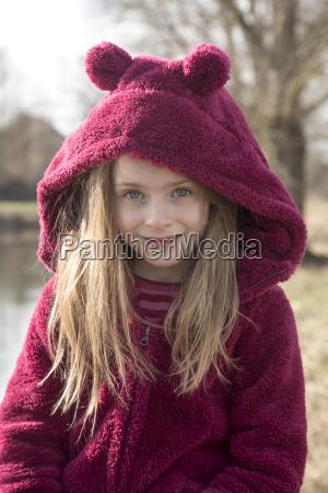 portrait of smiling girl wearing plush