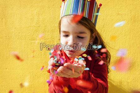 portrait of little girl wearing paper