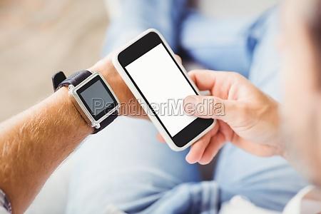 man, wearing, smart, watch, and, using - 17466858