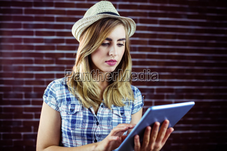 pretty blonde woman using tablet