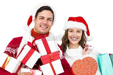 happy couple with santa hats holding