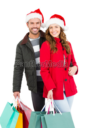 happy young couple holding shopping bags