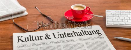 jornal na mesa cultura e entretenimento
