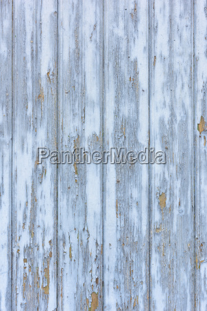 close up of weathered whitewashed barn