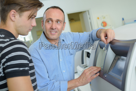 man showing younger man how to