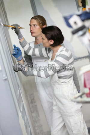 young woman painter in professional training