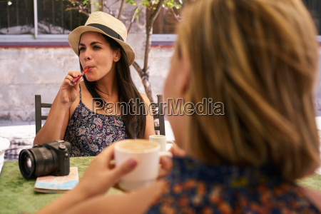 woman smoking electronic cigarette drinking coffee
