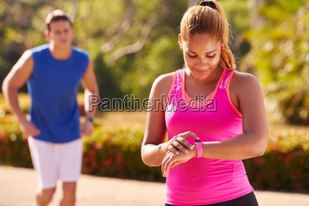 young woman sports training fitness fitwatch