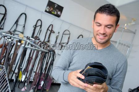 man buying leather