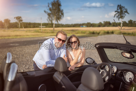 couple is leaning on the open