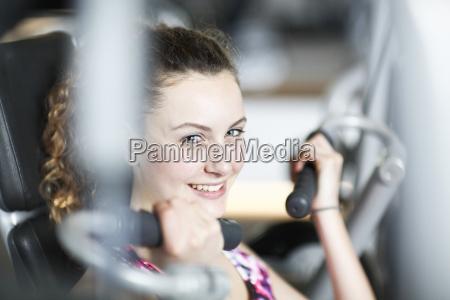portrait of teenage girl in gym