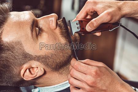cliente hipster loja de visitar barbeiro