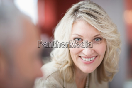 close up of businesswomans smiling face