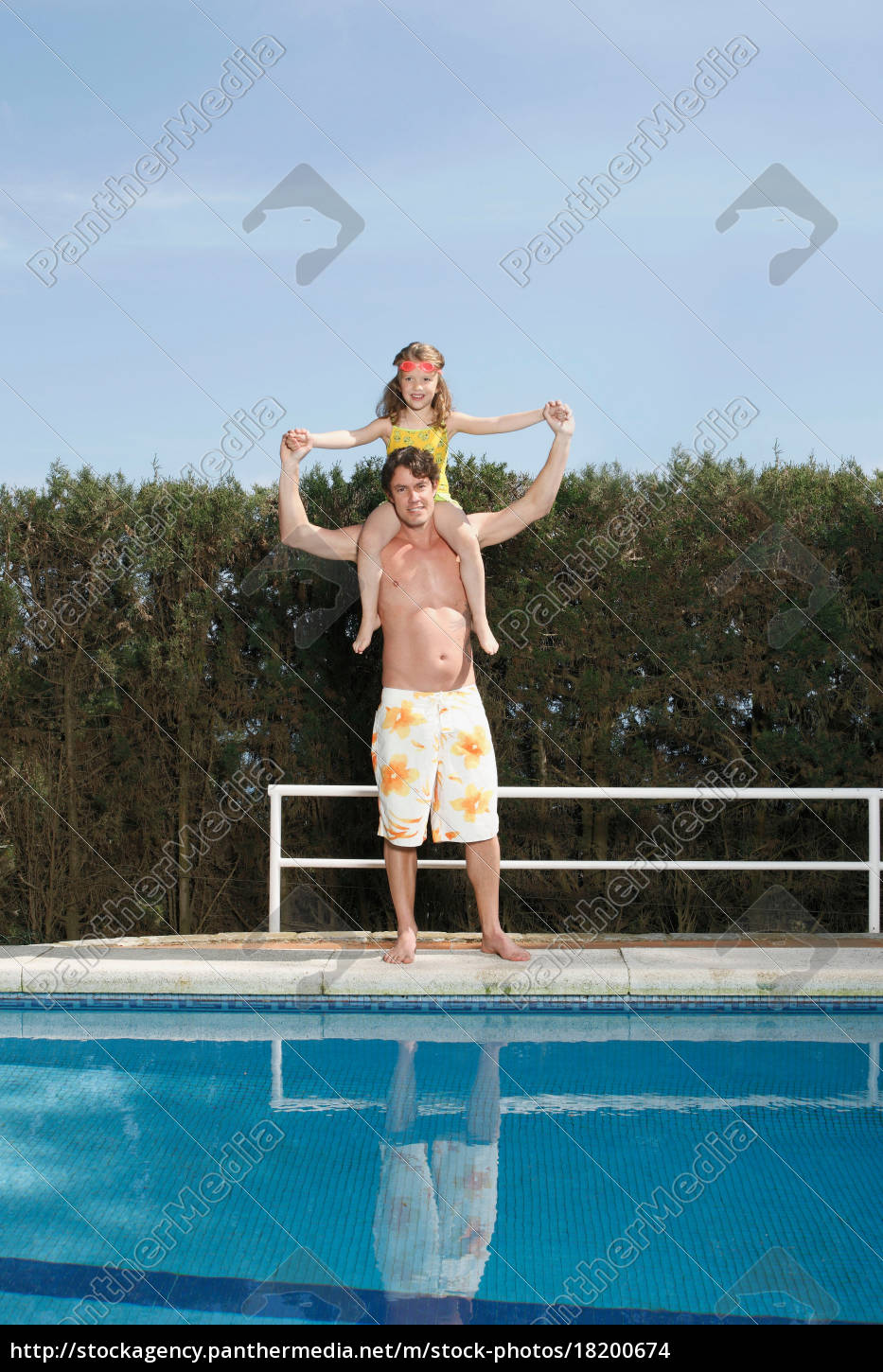 father, carrying, girl, by, pool - 18200674