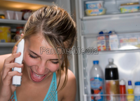 teen laughing girl on telephone